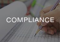Image: hand writing on a pad with the word compliance, click to access the on-demand compliance videos